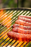 Sausage on the grill. On old wooden table stock images