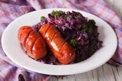 Sausage grill with stewed red cabbage close-up. horizontal Royalty Free Stock Photo