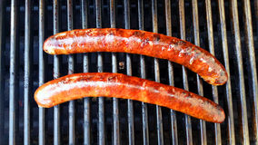 Sausage on the grill. Two Sausage's on the grill cooking Stock Photos
