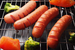 Sausage on the grill. With vegetables Stock Image