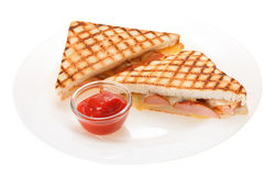 Sausage grilled cheese sandwich with tomato ketchup on a plate. Royalty Free Stock Images