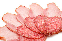 Sausage and ham. Even so delicious ham and salami slice on a white background Royalty Free Stock Images