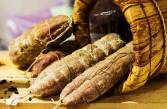 Sausage in a handmade basket. Different type of sausage in a handmade basket Stock Photo