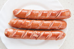 Sausage hot dog food at plate Royalty Free Stock Images