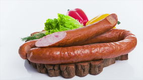 Sausage with hot peppers on white background stock video
