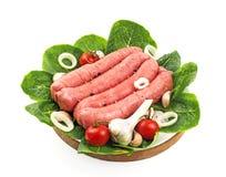 Sausage kebab 2. Sausage kebab with garlic and cherry on a wooden tray Royalty Free Stock Photos