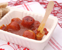 Sausage with ketchup Royalty Free Stock Photos