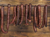 Sausage. Kind of sausage - wooden background Stock Photography