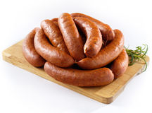 Sausage on kitchen board Royalty Free Stock Image
