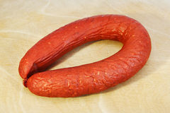 Sausage Krakovskaya on board Stock Images