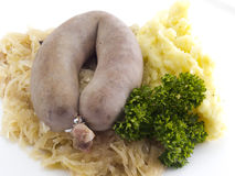 Sausage on kraut Stock Images