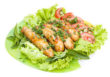Sausage with lettuce leaves Royalty Free Stock Photo