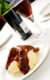Sausage and mash 2. Sausage and mash dish, light and airy feel with red wine in the background Stock Photo