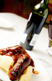 Sausage and mash 3. Sausage and mash dish with red wine in the background stock image