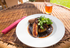 Sausage and mash with gravy in english pub Royalty Free Stock Photography