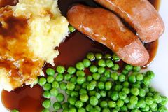 Sausage, Mash potato and green peas Stock Photos