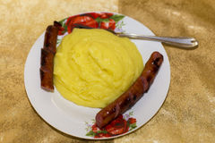 Sausage and mashed popato Stock Photos