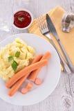 Sausage and mashed potato Stock Images