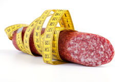 Sausage with a measuring tape Stock Photos