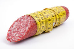 Sausage with a measuring tape Royalty Free Stock Image