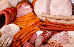 Sausage and meat. Cutting sausage and meat on a celebratory table Royalty Free Stock Photo