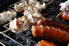 Sausage and meat on grill Royalty Free Stock Image