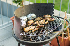 Sausage and meat on the grill. Royalty Free Stock Photos