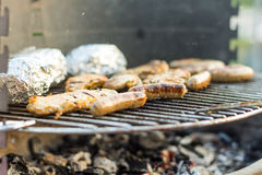 Sausage and meat on the grill. Stock Photos