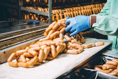 Sausage meat production. Conveyor factory industrial equipment stock photos
