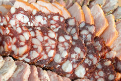 Sausage and meat sliced. Fat sausage and meat sliced Stock Photo