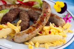 Sausage and minced meat-hamburger with dumplings Royalty Free Stock Images