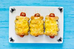 Sausage mummies or sausage aliens for Halloween. Funny snack royalty free stock image