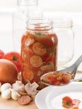 Sausage and mushroom sauce Stock Image