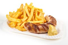 Sausage with Mustard and French Fries stock photos