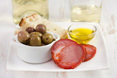 Sausage with olive Stock Photography
