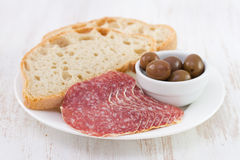 Sausage with olives Stock Photo