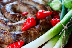 Sausage with onions and red pepper Stock Photography
