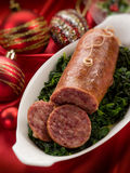 sausage over christmas table Stock Photo
