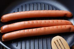 Sausage on the pan grill Stock Photos
