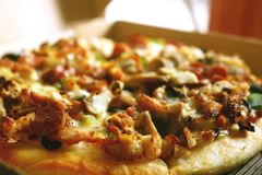 Sausage Pan Pizza Close up. Sausage delight pan pizza. Chicken sausages & onions with a double layer of mozzarella cheese stock images