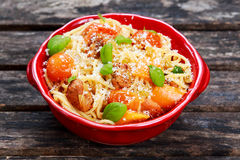 Sausage Pasta spaghetti with summer vegetables, cheese Royalty Free Stock Photo
