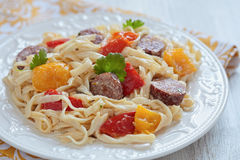 Sausage Pepper Fettuccini Skillet. On a table Stock Photo