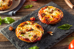 Sausage and Pepper Pizza Bagels Royalty Free Stock Images