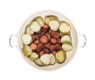 Sausage with Pickels. Freshly fried sausages with sour pickles in a round bowl ready to serve stock images