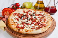 Sausage Pizza. With meat and cheese and oil stock photography