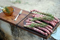 Sausage on the grill. Sausage placed on the grill ready to be roasted on the grill royalty free stock images