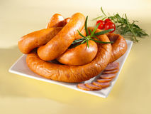 Sausage on a plate. Arrangement with sausage on a plate Stock Photography