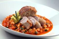 Sausage. A plate of German sausage with gravy Stock Photos