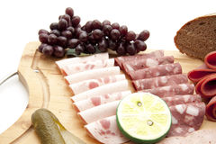 Sausage plate with grapes Royalty Free Stock Photo