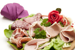 Sausage plate with rose Royalty Free Stock Photo